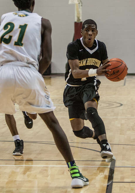 Sam Houston's Kendric Davis makes a move on Cy Falls' Kendall Scott during Thursday night's game at the Campbell Center. Photo: Michael Starghill, Jr., Photographer / © 2016 Michael Starghill, Jr.