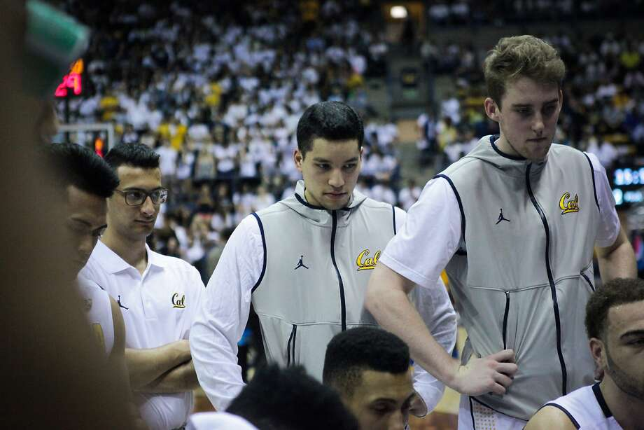 California Golden Bears guard Branden Glapion (32)  (center) listens to his coaches during a game against the UCLA Bruins, at Haas Pavilion, in Berkeley, California on Thursday, February 25, 2016. Photo: Gabrielle Lurie