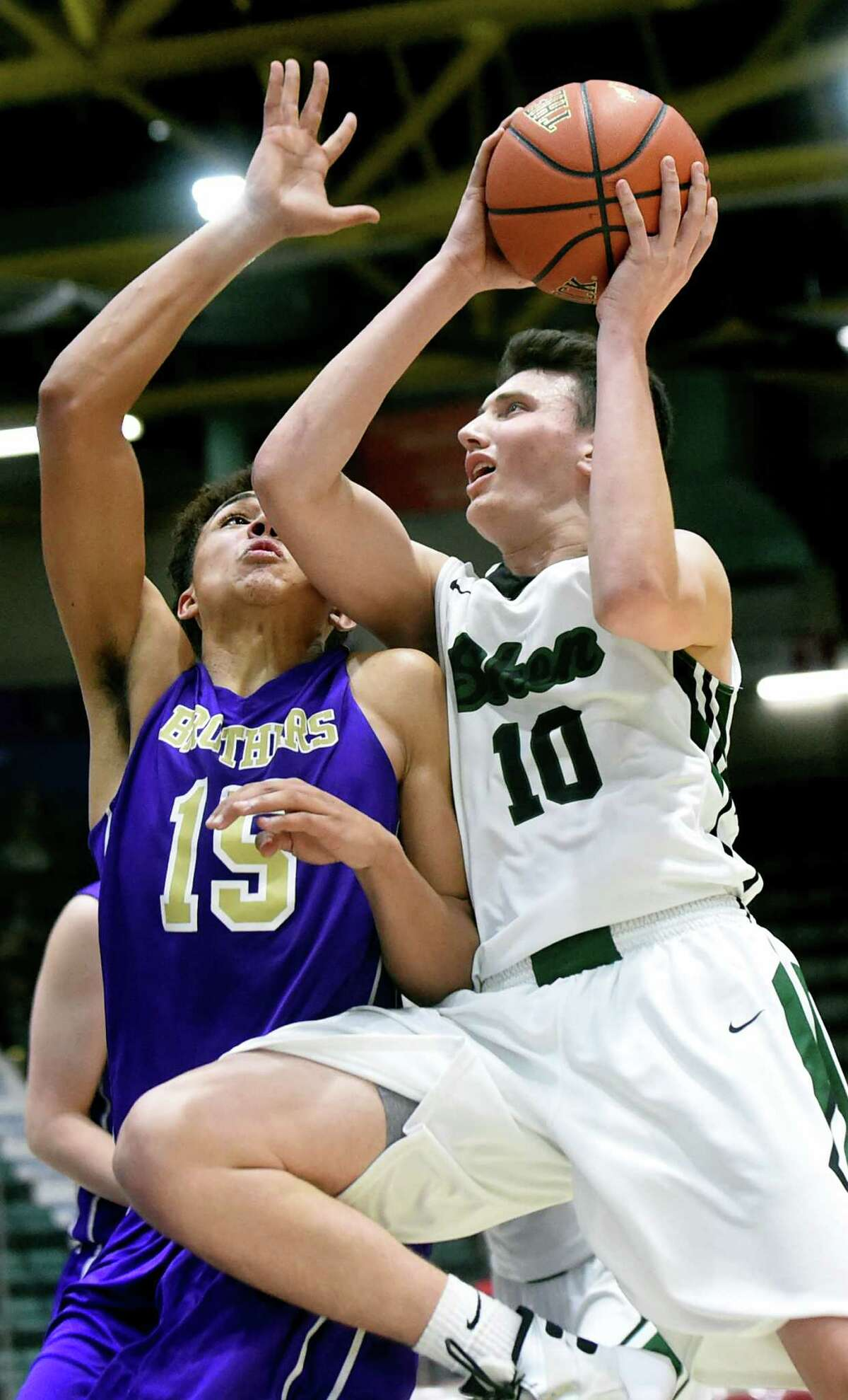 Shen's Luke Hicks, right, goes for the hoop as CBA's Mike Wynn defends during their Class AA basketball semifinal on Thursday, Feb. 25, 2016, at Glens Falls Civic Center in Glens Falls, N.Y. (Cindy Schultz / Times Union)