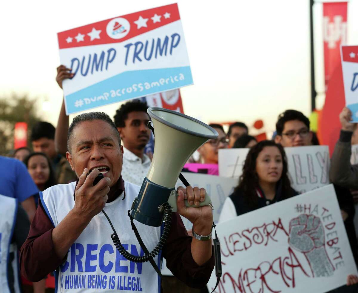 TeodoroAguiluz leads protesters in chants against Republican presidential candidate Donald Trump on Thursday before the Republican debate at the University of Houston.