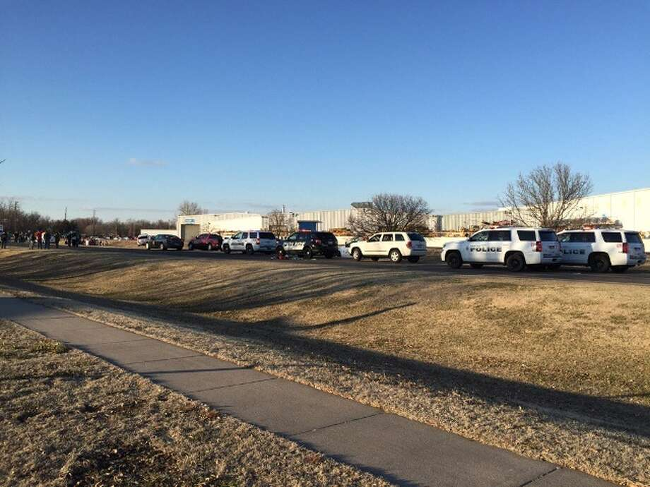 In this photo provided by KWCH-TV, police vehicles line the road after reports of a shooting at an industrial site in Hesston, Kan., Thursday, Feb. 25, 2016. (KWCH-TV via AP) MANDATORY CREDIT ORG XMIT: NY118 / KWCH-TV