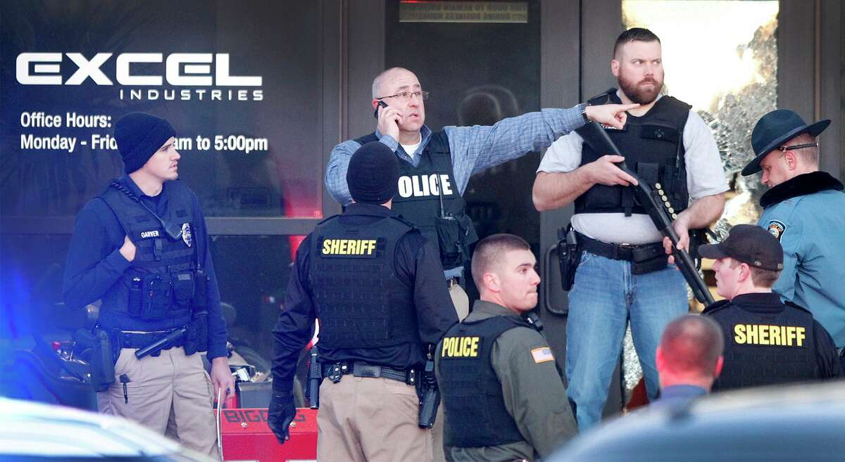 Police guard the front door of Excel Industries in Hesston, Kan., Thursday, Feb. 25, 2016, where a gunman killed an undetermined number of people and injured many more. (Fernando Salazar/The Wichita Eagle via AP) ORG XMIT: KSWIE101