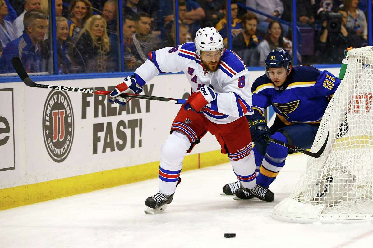 New York Rangers?' Kevin Klein, left, and St. Louis Blues?' Vladimir Tarasenko, of Russia, race for a loose puck behind the net during the first period of an NHL hockey game Thursday, Feb. 25, 2016, in St. Louis. (AP Photo/Billy Hurst) ORG XMIT: MOBH101