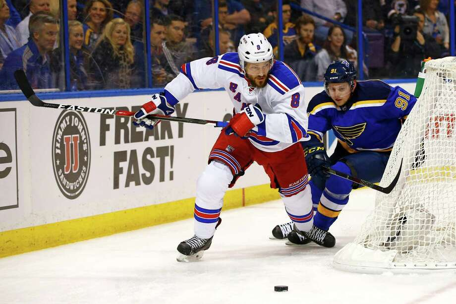 New York Rangers' Kevin Klein, left, and St. Louis Blues' Vladimir Tarasenko, of Russia, race for a loose puck behind the net during the first period of an NHL hockey game Thursday, Feb. 25, 2016, in St. Louis. (AP Photo/Billy Hurst) ORG XMIT: MOBH101 Photo: Billy Hurst / FR171248 AP