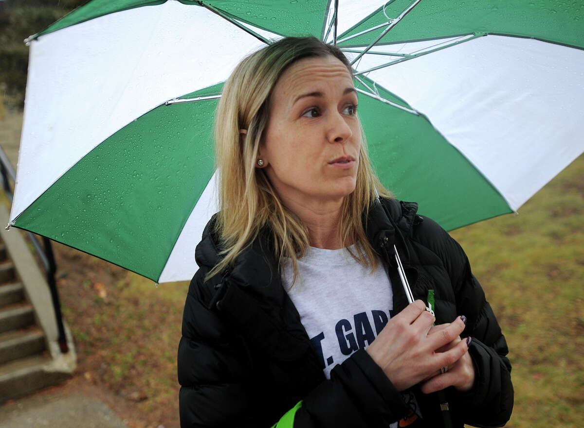 Mother of three boys who attend St. Gabriel School in Milford, parent Jaime Bereski, of Milford, discusses her thoughts on the school's announced closing as she waits outside the school on Wednesday.