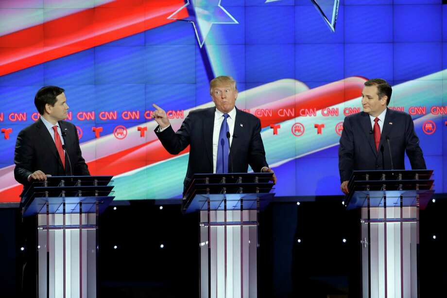 Republican presidential candidate, businessman Donald Trump, center, speaks as Republican presidential candidate, Sen. Marco Rubio, R-Fla., left, and Republican presidential candidate, Sen. Ted Cruz, R-Texas, right, look on during a Republican presidential primary debate at The University of Houston, Thursday, Feb. 25, 2016, in Houston. (AP Photo/David J. Phillip) Photo: David J. Phillip, STF / AP