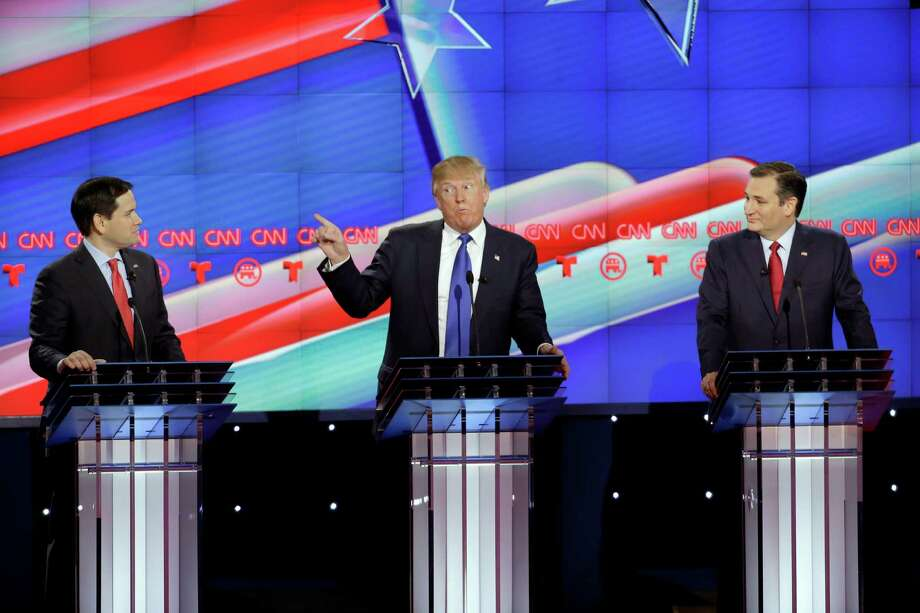 Republican presidential frontrunners Marco Rubio, Donald Trump and Ted Cruz argue on stage at the GOP presidential debate in Houston on Feb. 25.  Photo: David J. Phillip, STF / AP