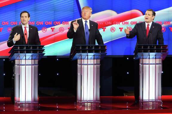 Marco Rubio, Donald Trump and Ted Cruz all talk over each other as they answer a question during the Republican Presidential Primary Debate at the University of Houston Thursday, Feb. 25, 2016.