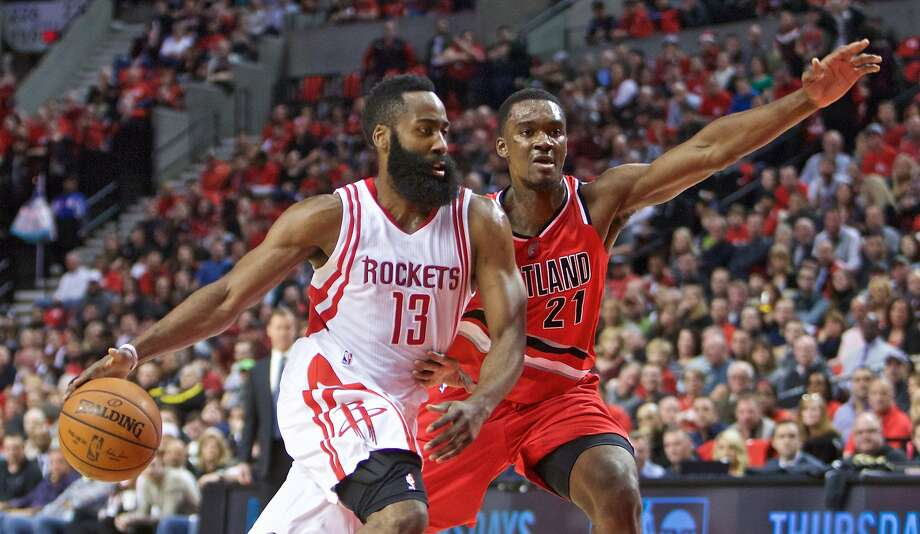 Portland's Noah Vonleh (right) is a step too slow as Houston's James Harden zips past him on his way to a 46-point game. Photo: Craig Mitchelldyer, Associated Press