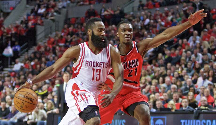 Rockets CEO Tad Brown says Rockets guard James Harden (13) never called for Kevin McHale to be fired or that he pushed for Dwight Howard to be traded. Photo: Craig Mitchelldyer, FRE / FR170751 AP