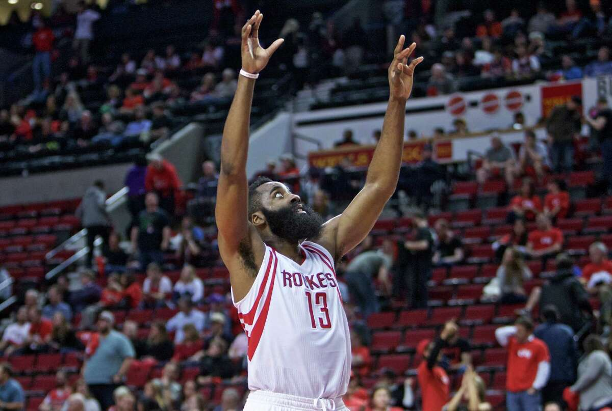 Houston Rockets guard James Harden reacts during the second half of the team's NBA basketball game against the Portland Trail Blazers in Portland, Ore., Thursday, Feb. 25, 2016. Harden scored 46 points as the Rockets won 119-105. (AP Photo/Craig Mitchelldyer)