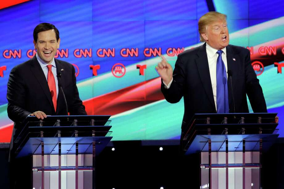 Republican presidential candidate, Sen. Marco Rubio, R-Fla., left, reacts as Republican presidential candidate, businessman Donald Trump speaks during a Republican presidential primary debate at The University of Houston, Thursday, Feb. 25, 2016, in Houston. (AP Photo/David J. Phillip) ORG XMIT: TXKJ132 Photo: David J. Phillip / AP