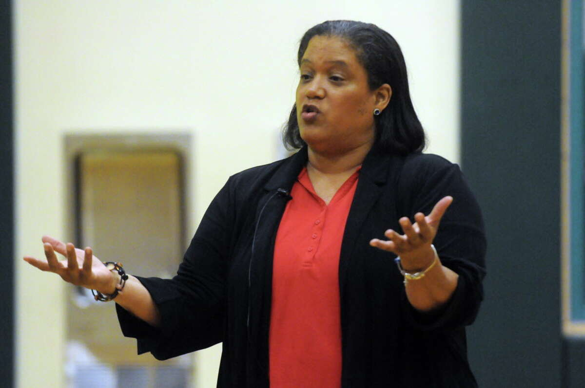 Superintendent Marguerite Vanden Wyngaard speaks during a public hearings for the three schools affected by the new state receivership law at Philip J. Schuyler Achievement Academy on Tuesday Aug. 11, 2015, in Albany, N.Y. The Albany school board signed off on a separation agreement that promised the embattled superintendent a $90,000 lump sum and continued pay at her nearly $197,000-a-year rate through the end of June. (Michael P. Farrell/Times Union archive)
