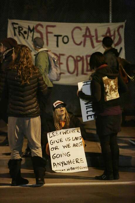 Homeless supporters hold signs Friday on Division Street. Photo: Lea Suzuki, The Chronicle