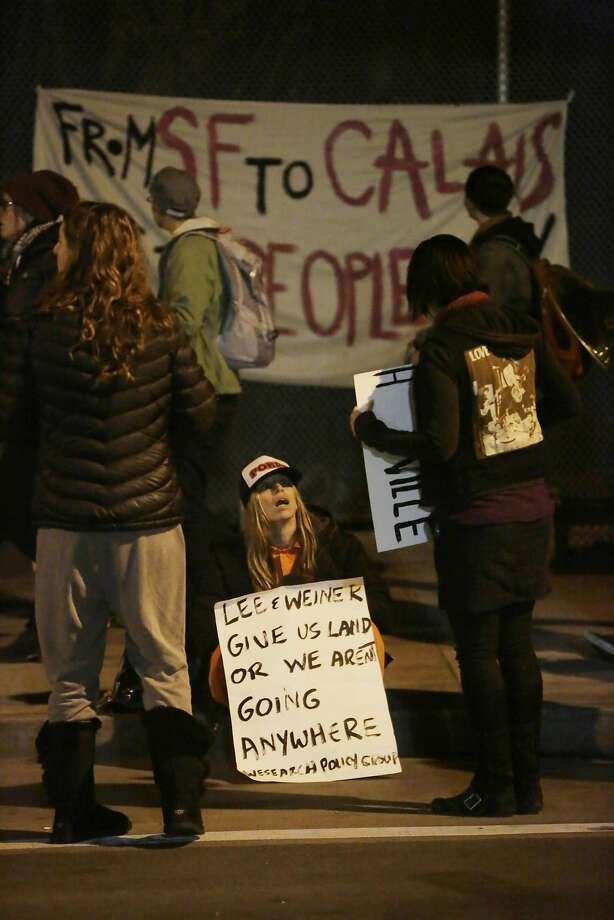 Homeless supporters hold signs  along 13th Street during a vigil in the early morning on Friday, February 26, 2016 in San Francisco, California. Photo: Lea Suzuki, The Chronicle