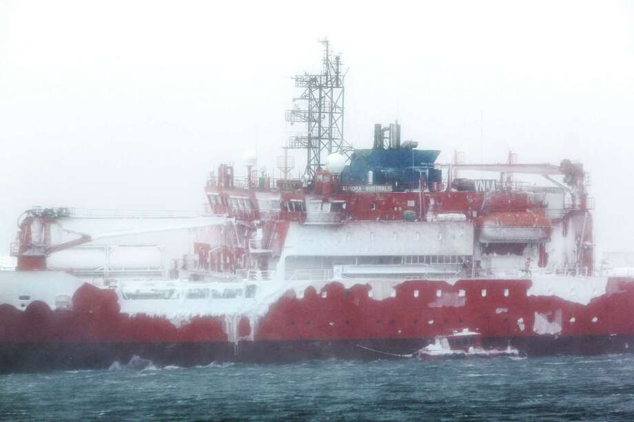 A handout photo taken by Chris Hill and provided by Australian Antarctic Division on February 26, 2016 shows Australia's flagship icebreaker Aurora Australis after it ran aground at Australia's Mawson research station in Antarctica. Expeditioners stranded on Australia's flagship icebreaker since it ran aground in Antarctica are set to be taken off by barge on February 26 thanks to a break in the weather, before attempts to refloat the ship.  (AFP PHOTO / CHRIS HILL / AUSTRALIAN ANTARCTIC DIVISION) Photo: CHRIS HILL / AFP