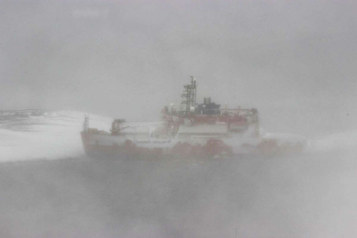 A photo taken on 25 February, 2016, received from the Australian Antarctic Division shows Australia's flagship icebreaker the Aurora Australis running aground at Mawson Station in Antarctica. The Australian Antarctic Division said on February 25, 2016 that the Aurora Australis has broken its mooring in a blizzard and run aground when the ship was on a resupply mission to the Mawson Station in Antarctica, leaving 67 expeditioners and crew stranded. (AFP PHOTO / AUSTRALIAN ANTARCTIC DIVISION)