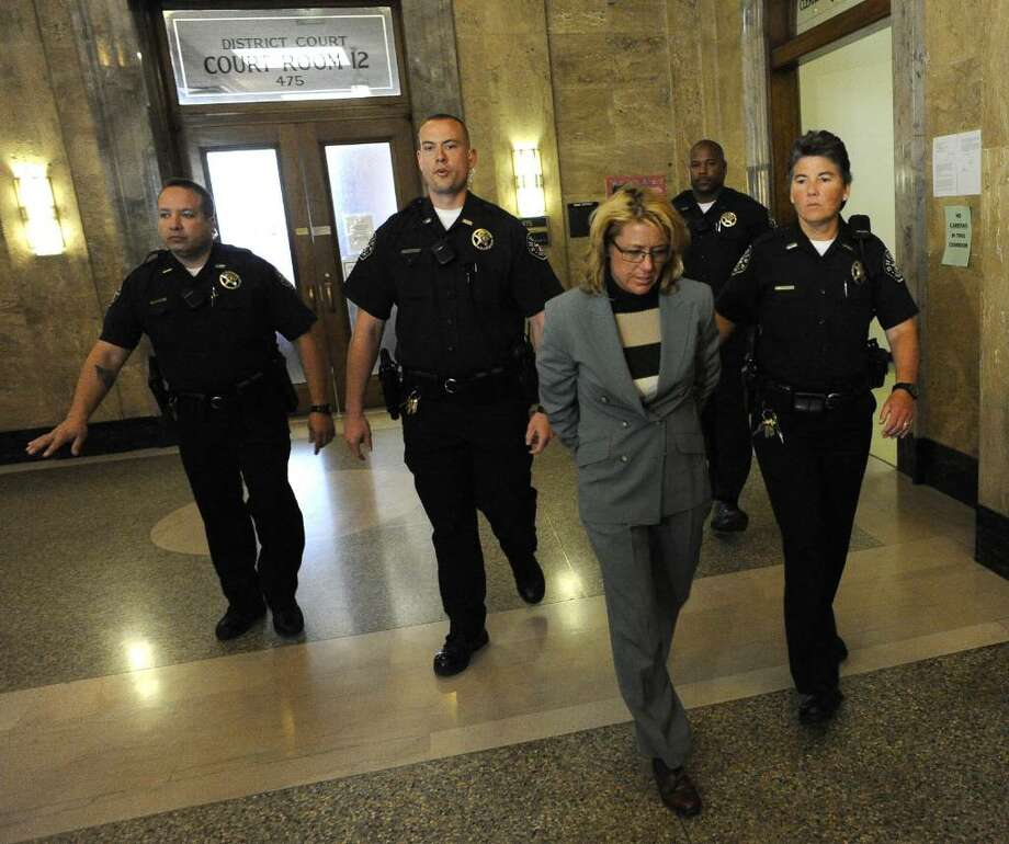 Sandra Jacobson is escorted by police through the court halls in Denver on Wednesday, April, 7, 2010 after she was found guilty of killing two Connecticut librarians while driving drunk and crashing into a taxi taking the victims to the Denver airport after a convention.  (AP Photo/The Denver Post, Judy DeHaas) Photo: Judy DeHaas, AP / The Denver Post