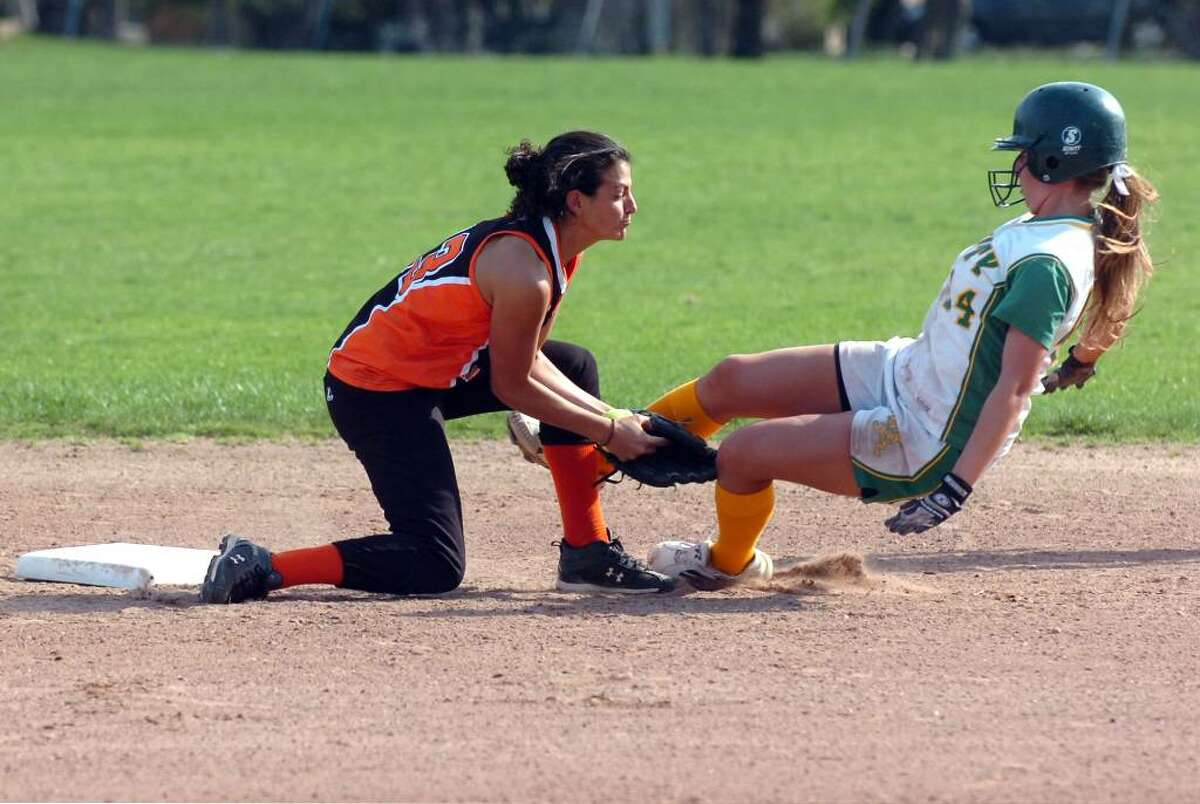 Stamford's Krista Robustelli tags Trinity's Tina Boehn out at second asTrinity Catholic hosts Stamford High in a girls softball game Wednesday afternoon, April 7, 2010.