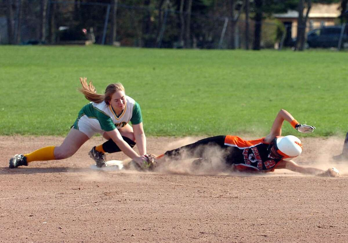 Trinity's Eileen Ornousky tags Stamford's Lindsey Wyanicky out at second as Trinity Catholic hosts Stamford High in a girls softball game Wednesday afternoon, April 7, 2010.