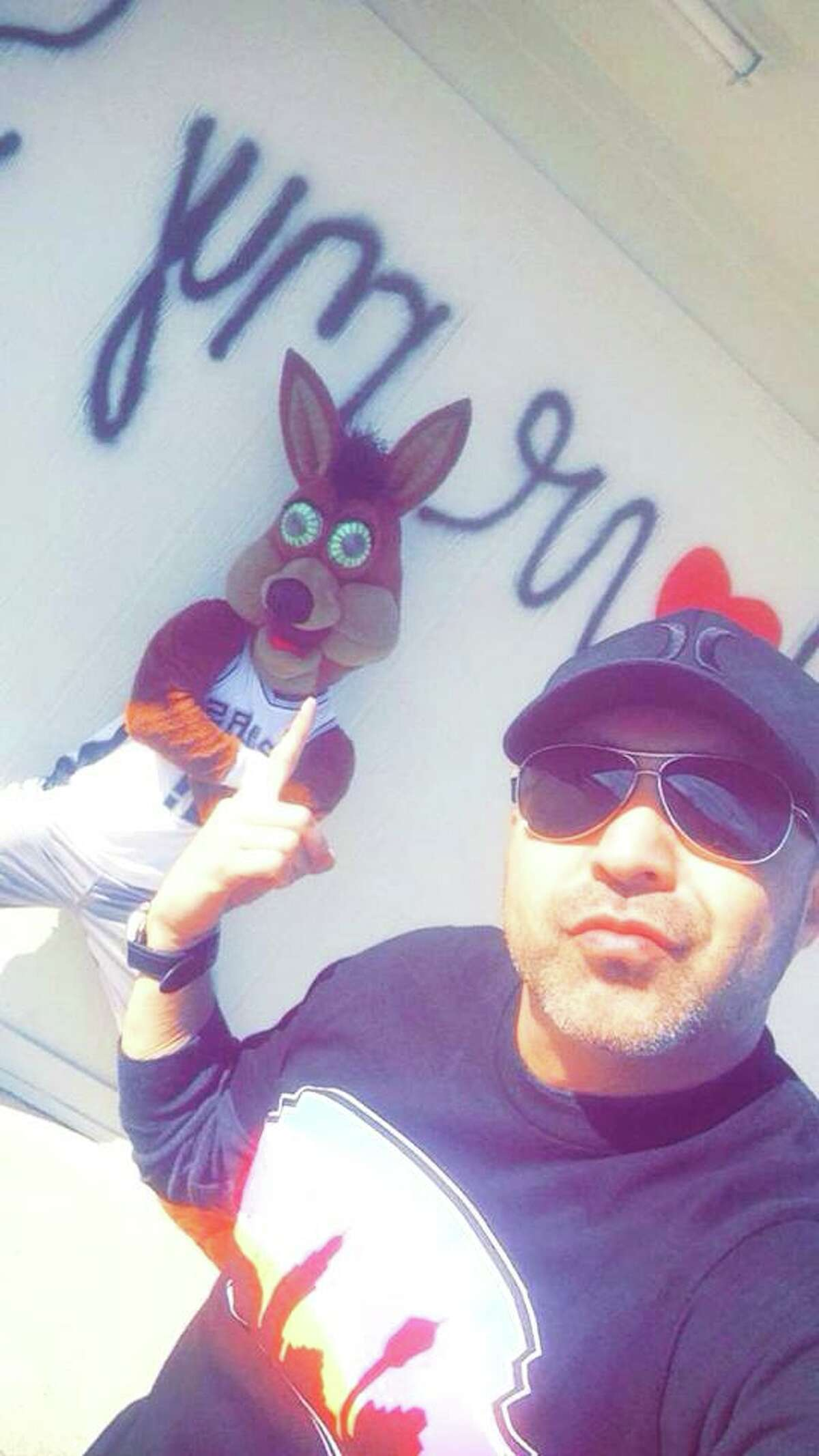 Luis Munoz with the Spurs Coyote posing with his latest piece of