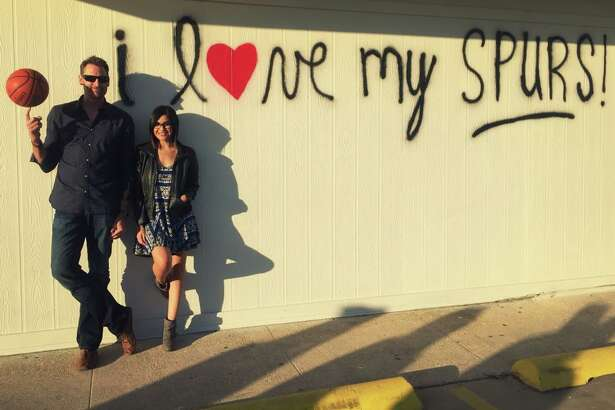 Former Spur Brent Barry and Nina Duran were the first San Antonians to pay the wall a visit.