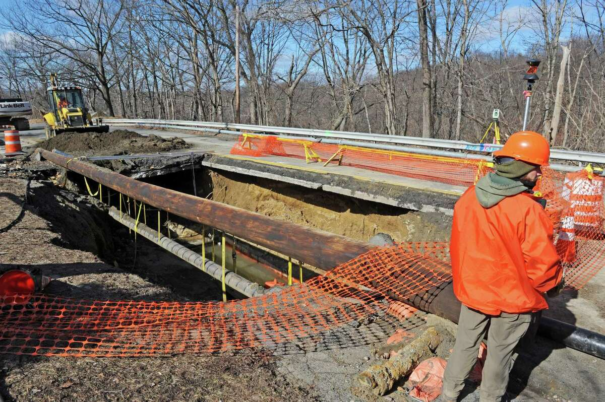Work continues on the repair of a sinkhole on Campbell Avenue Friday Feb. 26, 2016 in Troy, N.Y. (Michael P. Farrell/Times Union)