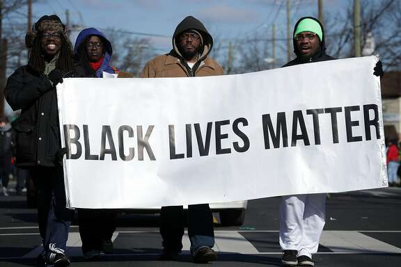 WASHINGTON, DC - JANUARY 18:  Members of Black Lives Matter DMV participate in the annual Martin Luther King Holiday Peace Walk and Parade January 18, 2016 in Washington, DC. The nation observes the life and legacy of Martin Luther King Jr. today.  (Photo by Alex Wong/Getty Images)