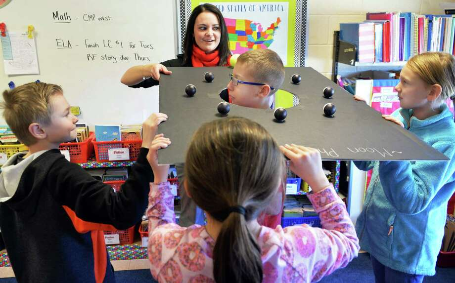 Fifth grade teacher Heather Cipperly, top, works with students using a moon phase board during their science lesson at Tamarac Elementary School Friday Feb. 26, 2016 in Troy, NY.  (John Carl D'Annibale / Times Union) Photo: John Carl D'Annibale / 0227_tamarac