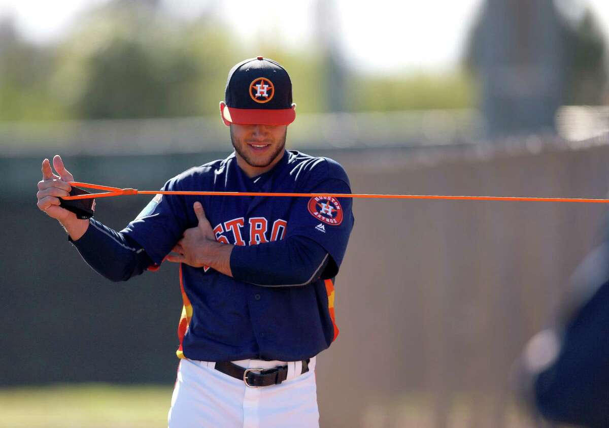 Houston Astros pitcher Lance McCullers warms up his arm at the Astros spring training in Kissimmee, Florida, Friday, Feb. 26, 2016.