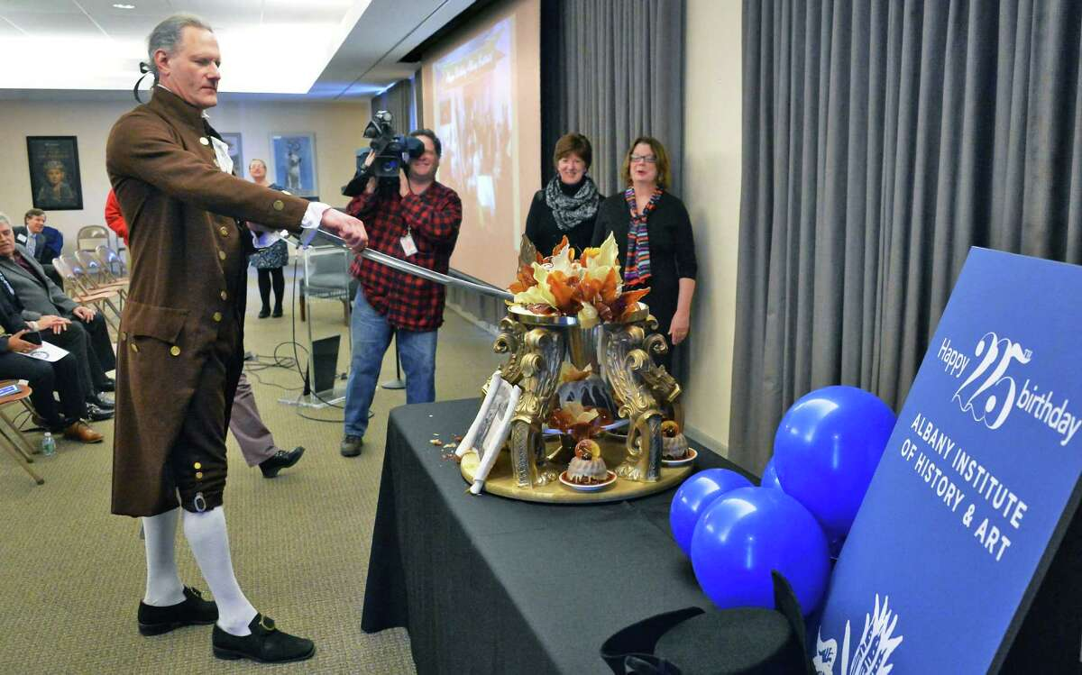 President George Washington reenactor John Koopman III, left, cuts a special birthday cake for The Albany Institute of History & Art's 225th birthday Friday Feb. 26, 2016 in Albany, NY. (John Carl D'Annibale / Times Union)