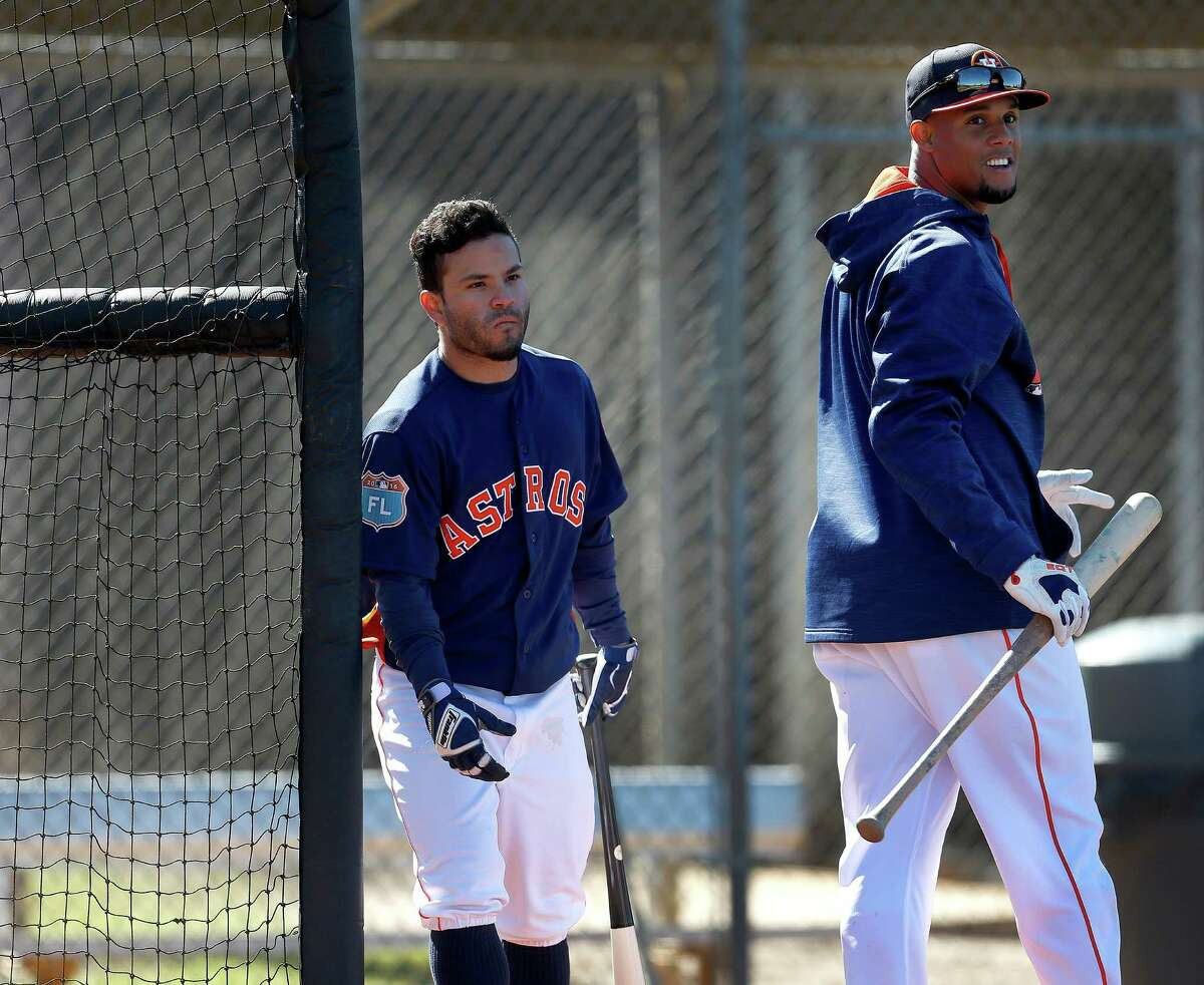 Houston Astros infielder Carlos Gomez walks out from the batting cage as Jose Altuve enters it at the Astros spring training in Kissimmee, Florida, Friday, Feb. 26, 2016.