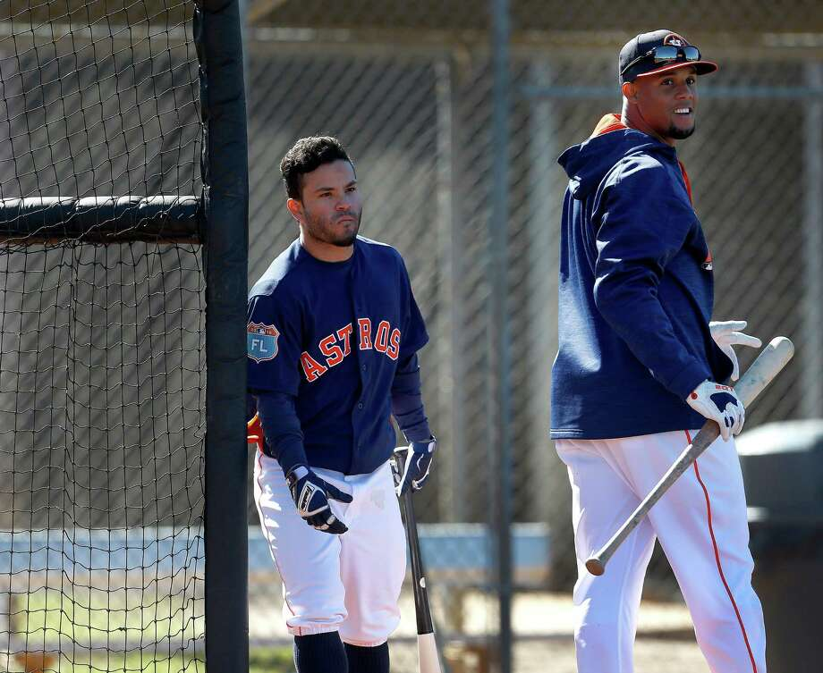 Houston Astros infielder Carlos Gomez walks out from the batting cage as Jose Altuve enters it at the Astros spring training in Kissimmee, Florida, Friday, Feb. 26, 2016. Photo: Karen Warren, Houston Chronicle / © 2015  Houston Chronicle
