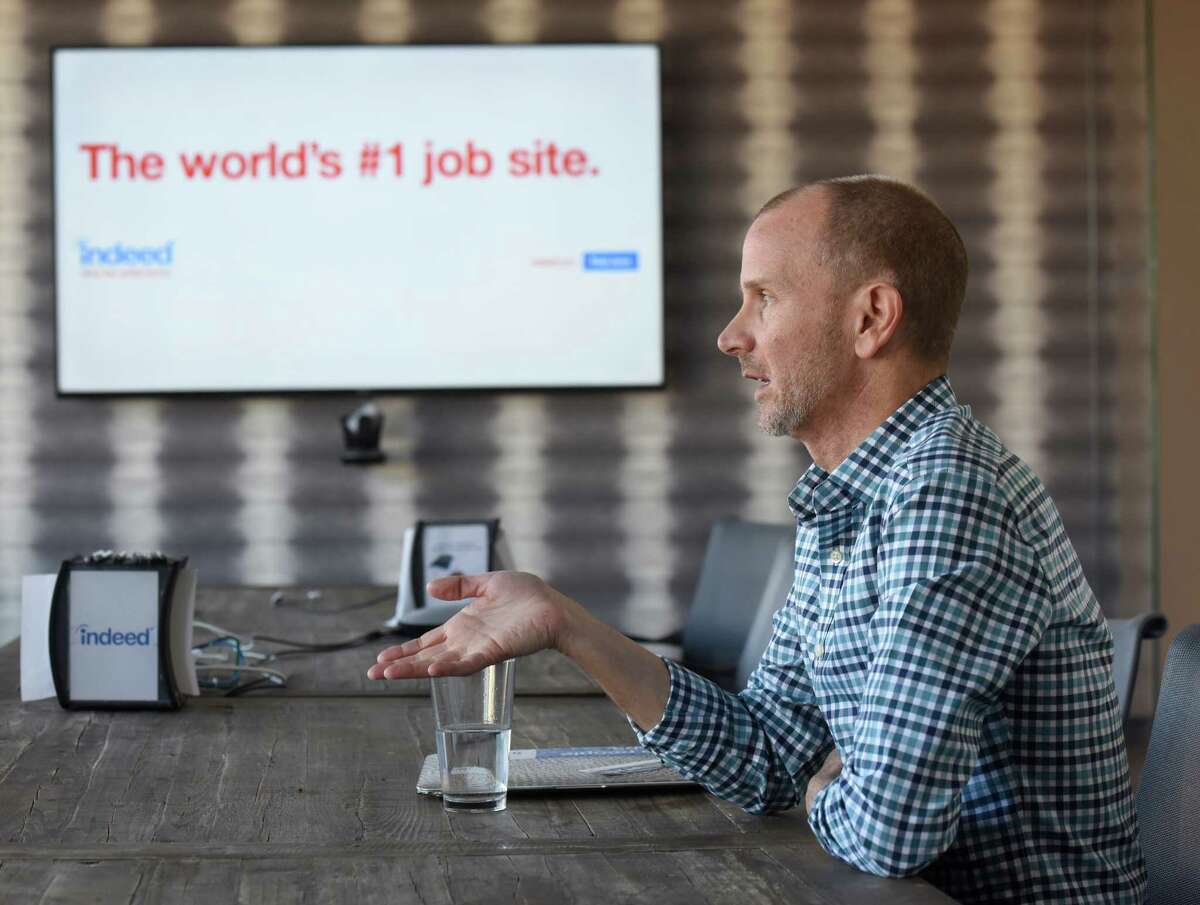 Indeed Senior Vice President of Human Resources Paul Wolfe speaks in the conference room at the Indeed Stamford Headquarters in Stamford.