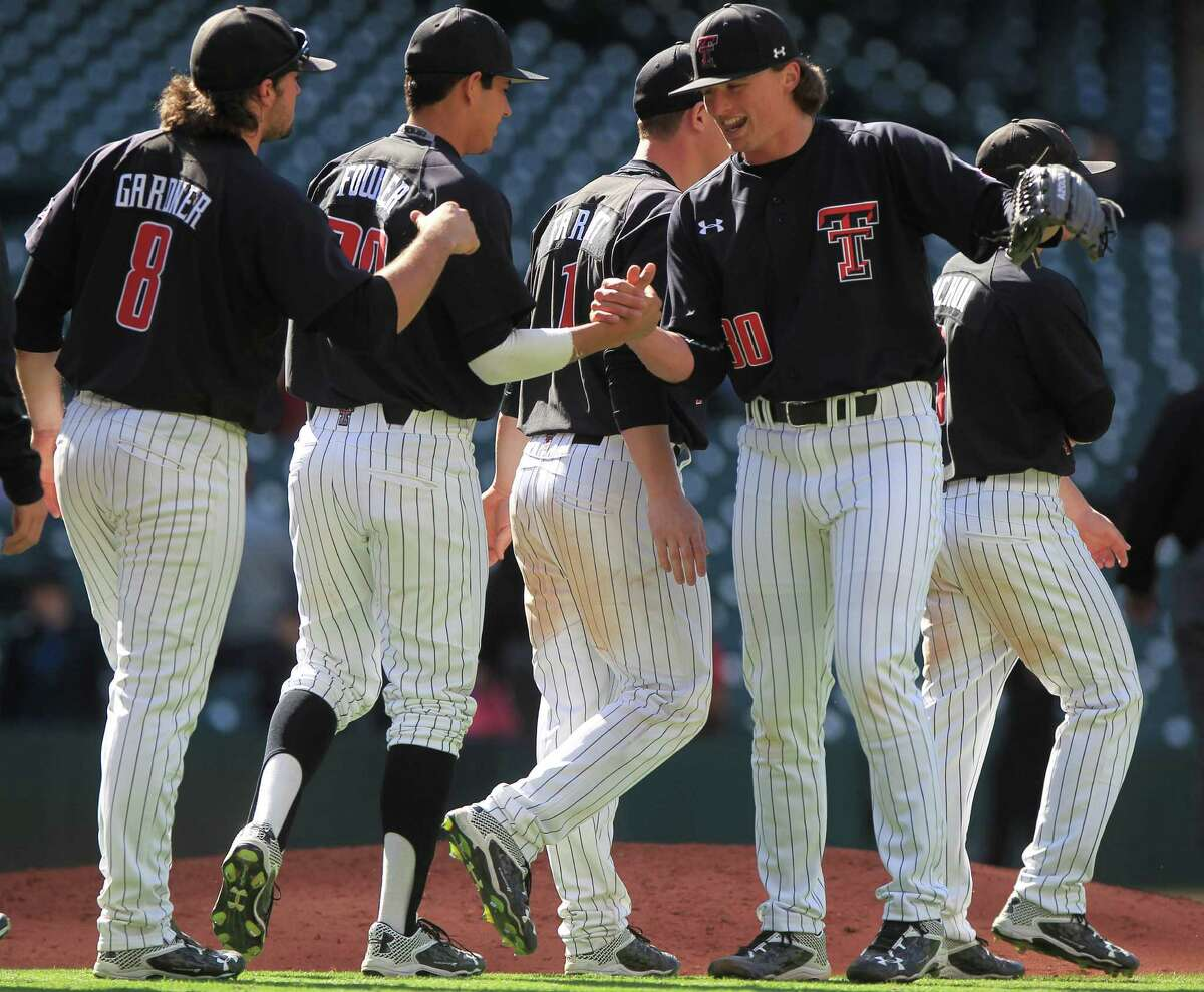 Texas Tech pitcher Davis Martin (30) is congratulated by teammates after closing out the ninth inning of the Houston College Classic at Minute Maid Park Friday, Feb. 26, 2016, in Houston.