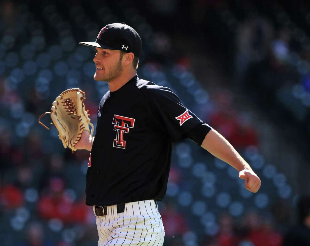 Texas Tech pitcher Hayden Howard (45) celebrates after closing out the eighth inning of the Houston College Classic at Minute Maid Park Friday, Feb. 26, 2016, in Houston.
