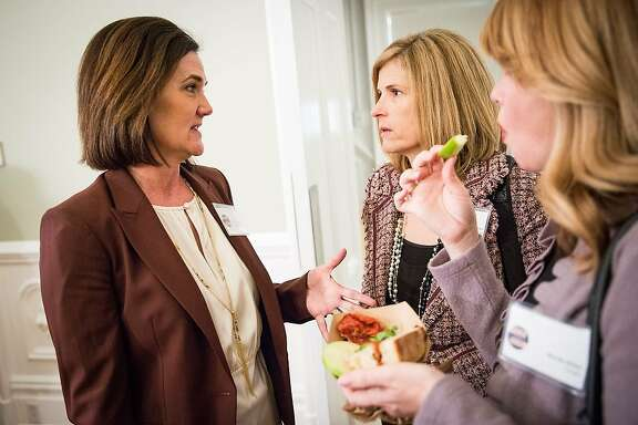 Political Solutions co-founders Stacy Dwelley, left, and Tami Miller, center, at a recent Sacramento event.  Politicians, lobbyists and journalists mingle at a #WinLikeAGirl reception at the Governor's Mansion in Sacramento, California, February 11, 2016.