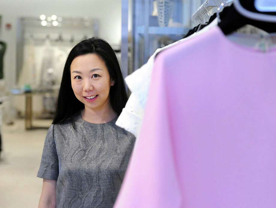 Grace Kang, a fashion designer at Olivine Gabbro at 243 Greenwich Ave. Thursday, Feb. 25, 2016. Kang has designed a dress for Greenwich resident Avril Graham, a fashion editor for a magazine, who will be wearing that dress to the upcoming Oscars. Photo: Bob Luckey Jr. / Hearst Connecticut Media / Greenwich Time
