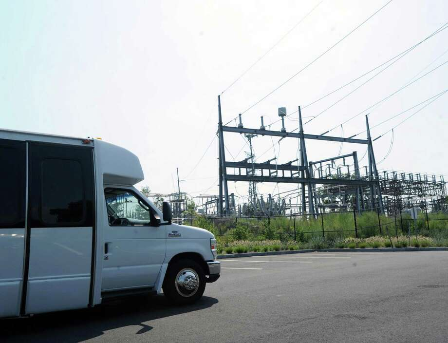 The Connecticut Siting Council tour bus passes by the Cos Cob substation in the Cos Cob section of Greenwich, Conn., Tuesday, Sept. 1, 2015. Photo: Bob Luckey Jr. / Hearst Connecticut Media / Greenwich Time