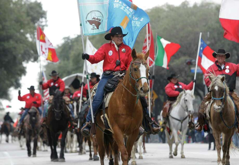 Members of the Texas Independence Trail Ride  ride in the Houston Livestock Show and Rodeo Parade in downtown Saturday, Feb. 28, 2015, in Houston. ( Melissa Phillip / Houston Chronicle ) Photo: Melissa Phillip, Staff / © 2014  Houston Chronicle