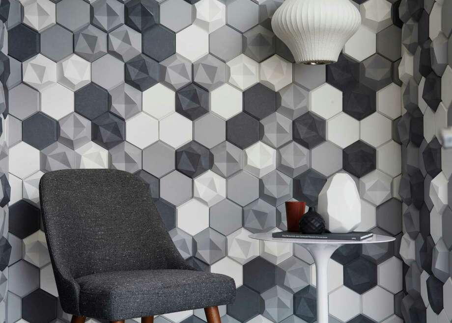 Edgy, from Walker Zanger's Kaza collection, features a recurring hexagonal base with alternating convex and concave patterns.  Edgy, from Walker Zanger's Kaza collection, features a recurring hexagonal base with alternating convex and concave patterns.