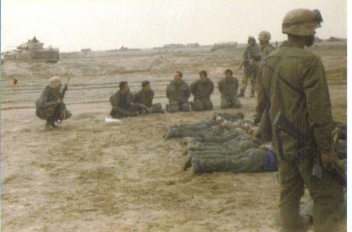 """Mike Glenn (far left) in the Gulf War: """"As the tankers in my cav troop continued their fight, I led my infantry mortar soldiers and artillery forward observers on a mission to clear a series of bunkers at an airstrip near the Rumaila oil field in the Euphrates Valley of southern Iraq.... I let the Iraqi enlisted soldiers sit up but told the officers to get on their stomachs."""""""