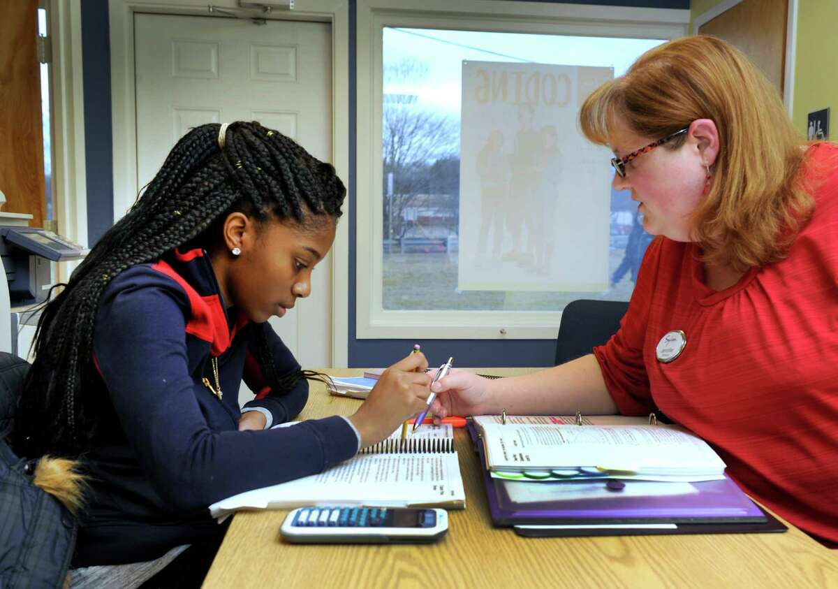 Zhane Dimmitt, 16, left, a junior at Danbury High School, studies for her SATs with Jennifer Berth, co-director of the Sylvan Learning Center in Brookfield.