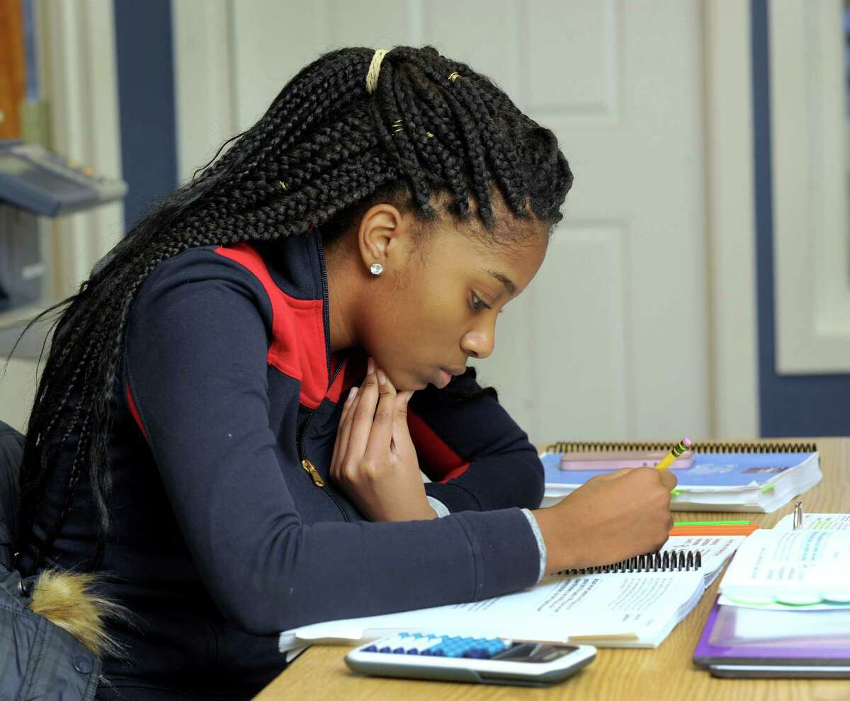 Zhane Dimmitt, 16, left, a junior at Danbury High School, studies for her SAT at the Sylvan Learning Center in Brookfield