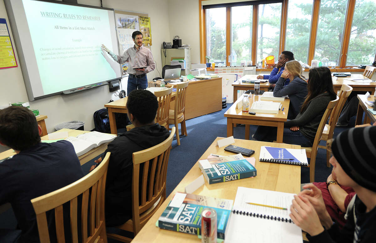 Carnegie Pollack SAT teacher Peter Scotch prepares students for the verbal section of the test during the company's SAT prep class at Greens Farms Academy in Westport, Conn. on Sunday, February 21, 2016.