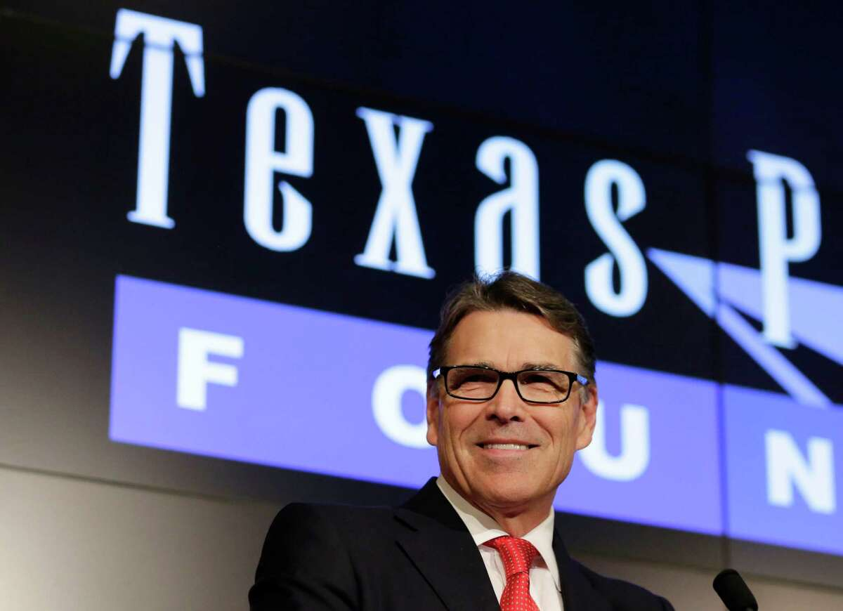 Former Texas Gov. Rick Perry speaks during a news conference Wednesday in Austin, Texas. The felony prosecution against Perry ended Wednesday when the state's highest criminal court dismissed an abuse-of-power indictment that the Republican says hampered his short-lived 2016 presidential bid.