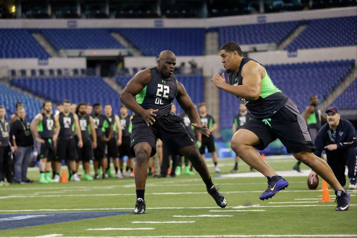 Texas A&M offensive lineman Germain Ifedi, left, blocks Texas Christian offensive lineman Halapoulivaati Vaitai a drill at the NFL football scouting combine in Indianapolis, Friday, Feb. 26, 2016. (AP Photo/Michael Conroy)