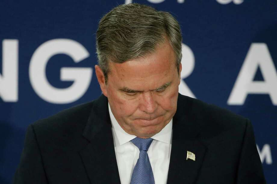 Former Florida Gov. Jeb Bush announces a halt to his campaign Feb. 20 at the GOP presidential primary rally in Columbia, S.C. Photo: Matt Rourke, STF / AP