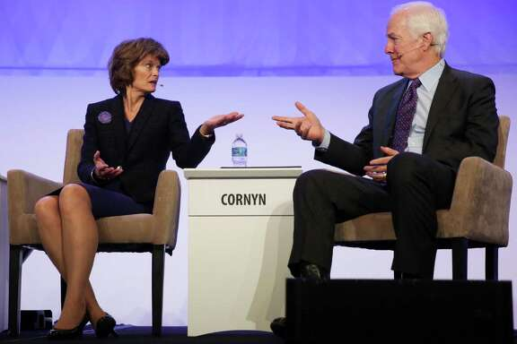 Sen. Lisa Murkowski, R-Alaska, and Sen. John Cornyn, R-Texas, defer a question to each other during a session Friday at IHS Energy CERAWeek.