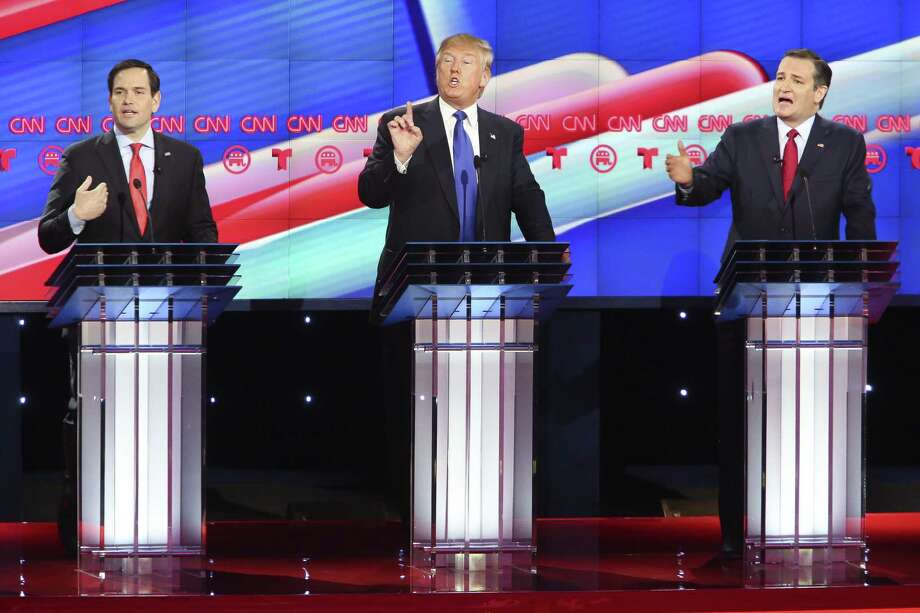Marco Rubio, left, Donald Trump and Ted Cruz talk over one another as they all try to answer a question during Thursday night's Republican presidential primary debate at the University of Houston. (Photo by Michael Ciaglo-Pool/Getty Images) Photo: Pool / 2016 Getty Images